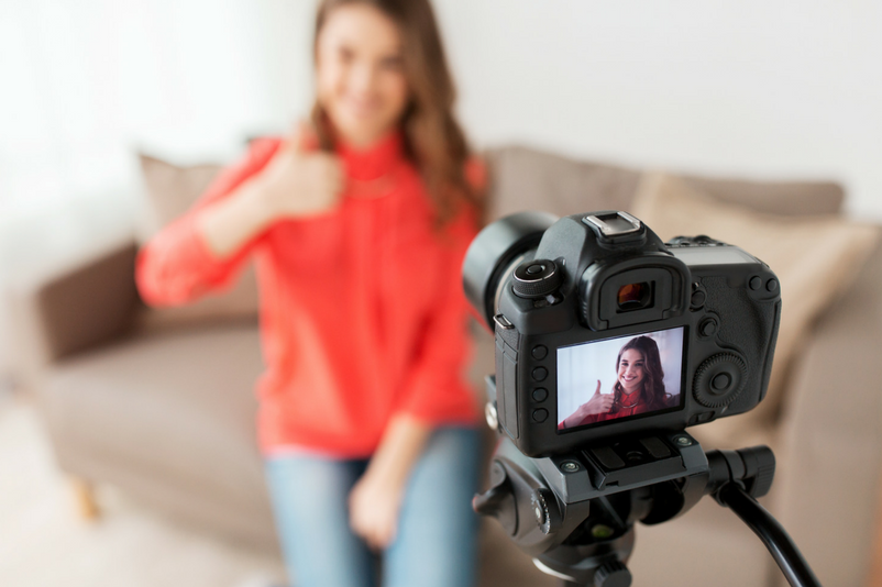 Online course creator in front of camera